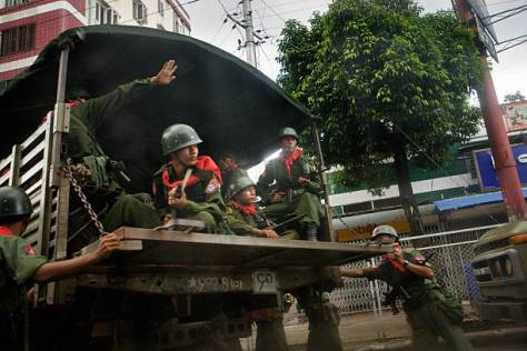 Burmese Government Soldiers sit inside a truck