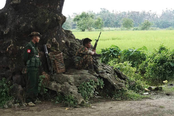 Myanmar Soldiers Stand Guard at a Check Post