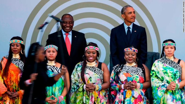 Barack Obama and Cyril Ramaphosa behind Soweto Gospel Choir